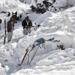 Lowari Top - Volunteers dig through the snow to recover 2 loaded trucks, which were buried in an avalanche that hit Ziarat Village near Lowari Top. At least seven people were killed