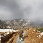Shangla Swat valley - Pakistani Army soldier walks on snow covered hills3