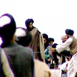 file photo taken in 1996 of a TV screen grab taken secretly by BBC Newsnight shows Taliban's one-eyed spiritual leader Mullah Mohammed Omar (C) during a rally of his troops in Kandahar