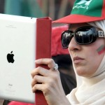 PTI Rally in Rawalpindi - woman with iPod