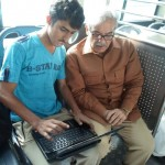Shahbaz Sharif checking laptop of a student in bus from model town to Minar e Pakistan