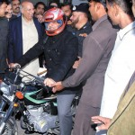 Shahbaz Sharif on Motor Cycle for Helmet for all drive