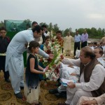Talal Ch. with children presenting flowers to Nawaz Sharif in Jaranwala election rally on 27/4/2013
