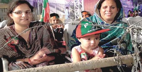 PTI Women in Sialkot Jalsa wirh a child